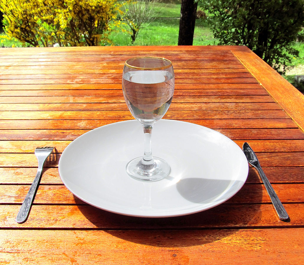 Glass of water on plate