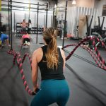 woman using fitness roaps